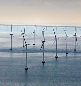 A number of offshore wind turbines. Photo.